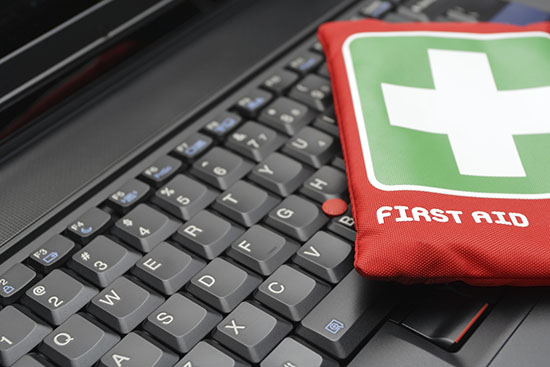 First aid kit on laptop keyboard
